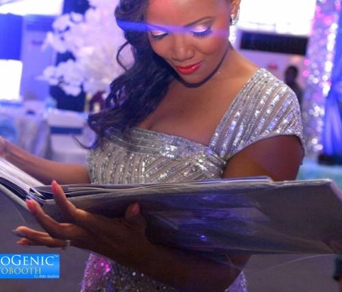 bride loving her photobooth guest book album